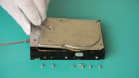 Technician shows deep dents on the hard disk Stock Image