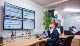 Technician sitting in office running diagnostics. In large data center royalty free stock photo