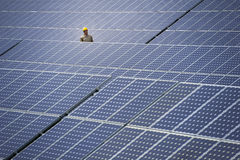 Technician at solar power station Royalty Free Stock Photo