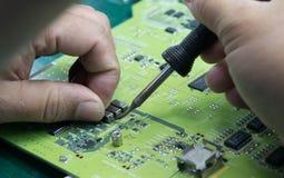 Technician soldering board. Technician soldering board electronic repair Royalty Free Stock Photo