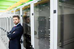 Technician standing with arms crossed in a server room Royalty Free Stock Images