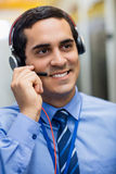 Technician talking on head phones Royalty Free Stock Photography
