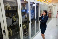 Technician talking on mobile phone Royalty Free Stock Images