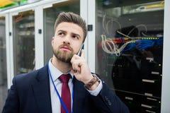 Technician talking on mobile phone Stock Photos