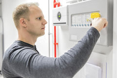 Technician test fire panel in data center Royalty Free Stock Photography