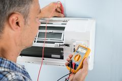Technician testing air conditioner stock images