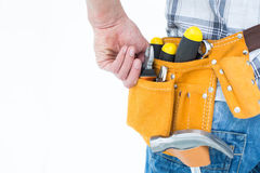 Technician with tool belt around waist Stock Images