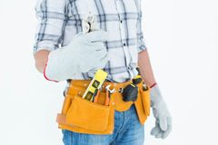 Technician with tool belt around waist holding pliers Royalty Free Stock Images