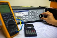 Technician turn switch of  precision multi calibrator for calibration multimeter Royalty Free Stock Image