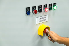 Technician is turning on emergency shutdown button. On control panel Royalty Free Stock Image
