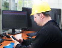 Technician typing the message in the power plant control center royalty free stock photos