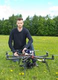 Technician With UAV Drone in Park royalty free stock photography