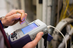 Technician using digital cable analyzer Stock Images