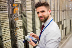 Technician using digital cable analyzer Stock Image