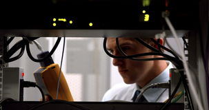 Technician using digital cable analyzer on server stock video footage
