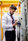 Technician using digital cable analyzer Royalty Free Stock Photo
