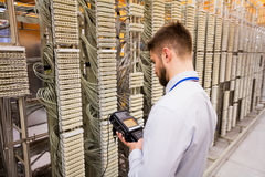 Technician using digital cable analyzer Stock Photography
