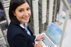 Technician using on laptop Stock Photography