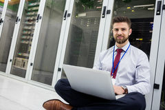 Technician using laptop Stock Image