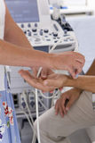 Technician using ultrasound treatment on patient?s wrist Stock Images