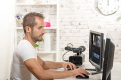 Technician video editor. On the computer with video camera royalty free stock photography