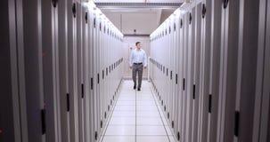 Technician walking in server hallway stock footage