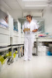 Technician Walking In Storage Room Royalty Free Stock Photos