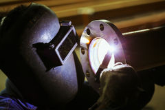 Technician welding metal pipe Royalty Free Stock Photography