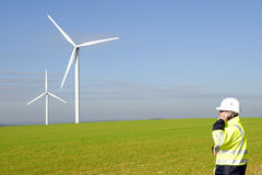 Technician and windmills Royalty Free Stock Photo