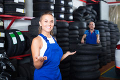 Technician woman in overalls standing in car workshop indoors Royalty Free Stock Images