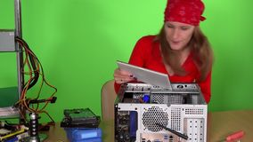 Technician woman with tablet computer examining pc at repair service stock video