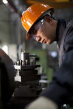 Technician at work. Asian technician working in factory shallow DOF Royalty Free Stock Images