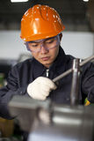 Technician at work. Asian technician working in factory shallow focus Stock Images