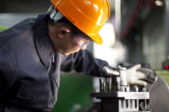 Technician at work. Asian technician working in factory shallow focus Royalty Free Stock Photos
