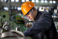 Technician at work. Asian technician working in factory shallow focus Royalty Free Stock Photo