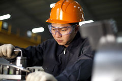 Technician at work. Asian technician working in factory shallow focus Stock Photo