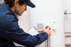 Technician at work adjusting a regulator royalty free stock photography