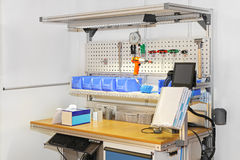 Technician workbench. Desk with tools and shelves Royalty Free Stock Image
