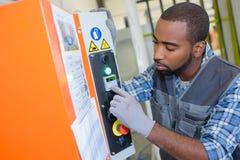 Technician worker adjusting elevator mechanism lift Royalty Free Stock Photos
