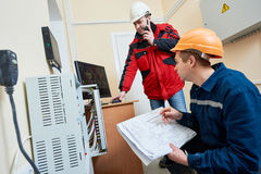 Technician worker adjusting video surveillance system. Technician workers agjusting position and signal of video surveillance camera system Royalty Free Stock Photos