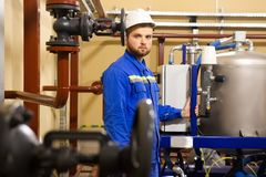 Technician worker on gas and oil refinery royalty free stock photography