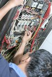 Technician working. On cables and wires Stock Image