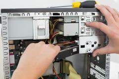 Technician working on broken computer Royalty Free Stock Image