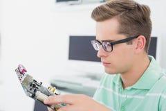 Technician working on broken cpu Stock Photos
