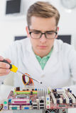 Technician working on broken cpu with screwdriver Stock Photos