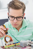 Technician working on broken cpu with screwdriver Royalty Free Stock Photos
