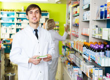 Technician working in chemist shop Stock Photos