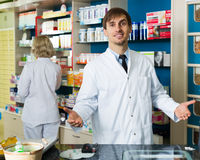 Technician working in chemist shop Stock Images