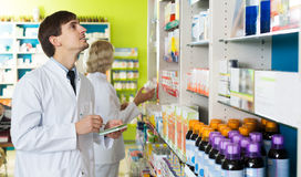 Technician working in chemist shop Royalty Free Stock Photos