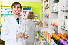Technician working in chemist shop Stock Image